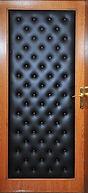 Элитная металлическая дверь с комбинированной панелью с элементами кожи и МДФ