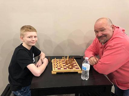Jim Bob and Gage playing chess.jpg