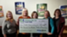 100 Women Seattle donation to The Pink Daisy Project
