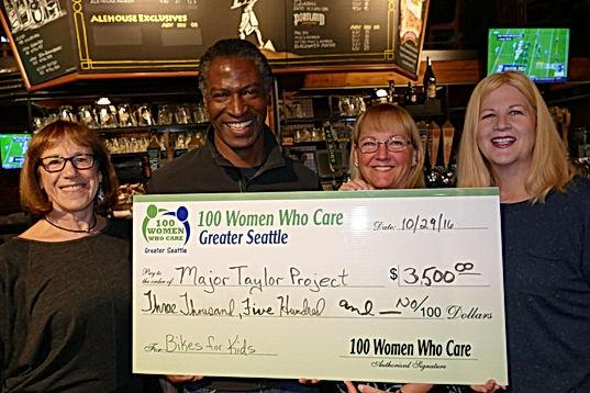 100 Women Seattle donation to Major Taylor Project Seattle Bike Club