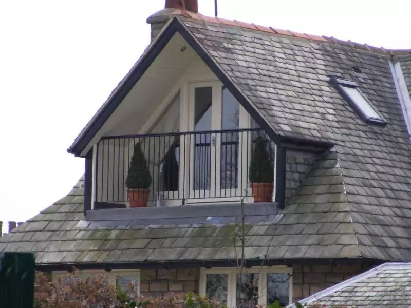 Sheltered Dormer Balcony with handrail