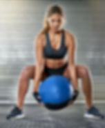Sporty Woman Lifting a Medicine Ball