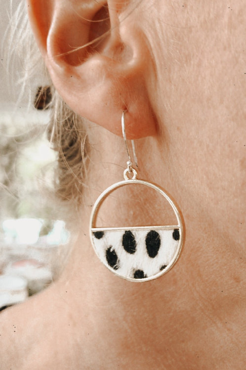 Framed cow earrings