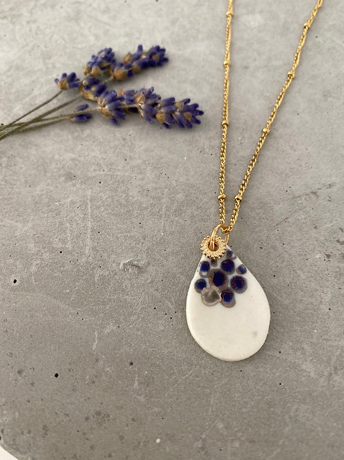 navy  gold dot porcelain tear necklace