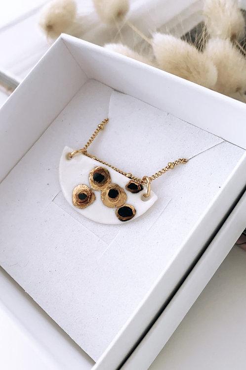 Black and gold porcelain crescent necklace