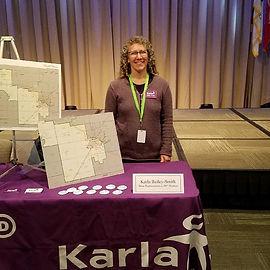 Karla with maps.jpeg