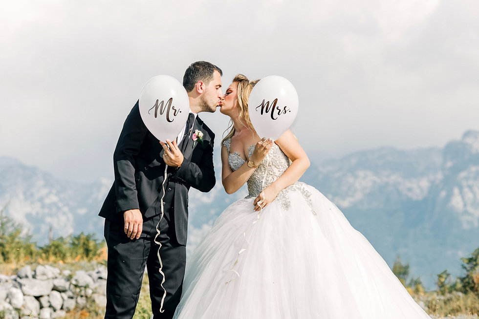 man-and-woman-kissing-while-holding-ball