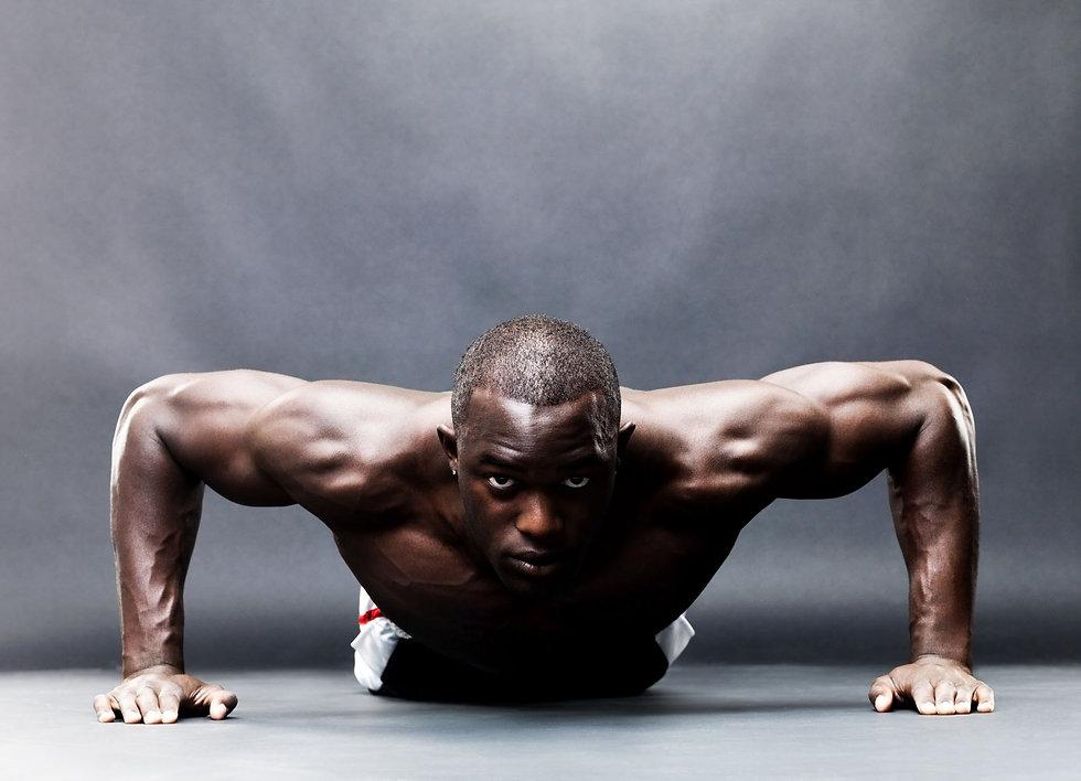close up front shot of man doing push ups
