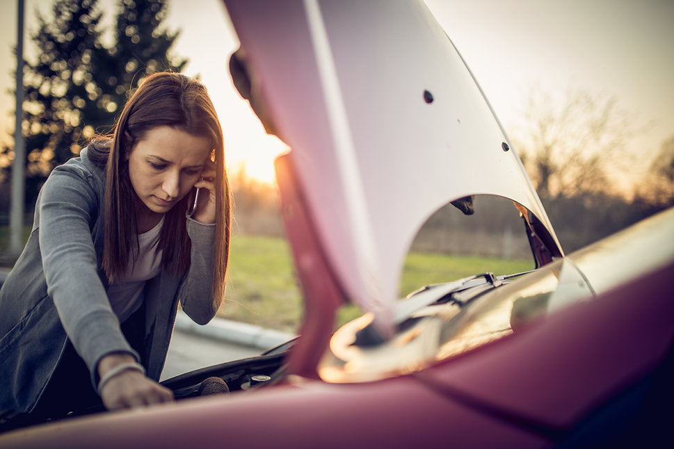 Woman on the phone to a mechanic to get help after breaking down Milton Keynes HC Car Repairs 2021