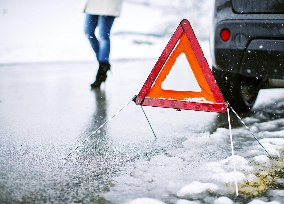 Red and orange warning triangle vehicle broken down during winter Milton Keynes HC Car Repairs 2021