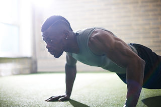 side view of guy doing push ups