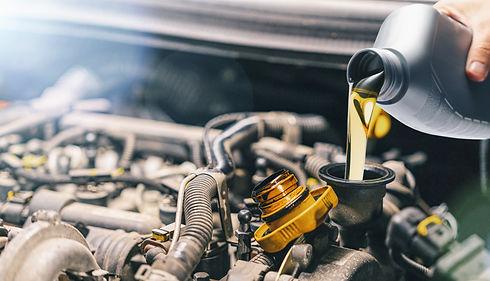 Mechanic filling up engine with oil Milton Keynes HC Car Repairs 2021