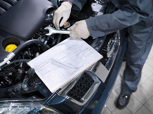 Mechanic with a spanner performing a mobile repair Milton Keynes HC Car Repairs 2021