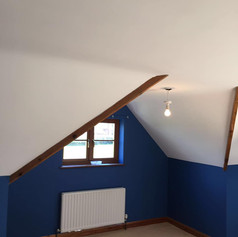 Room painted blue and white with exposed beams in private property by Phoenix Decorators Worcester