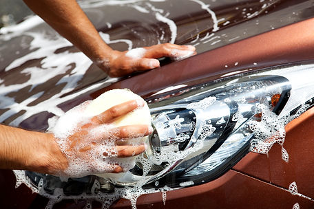 Car headlights being cleaned Orchard Auto Mobile Car Valeting 2021 Edinburgh