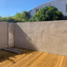 External diving wall after renovation, rendering, deck installation by Phoenix Decorators