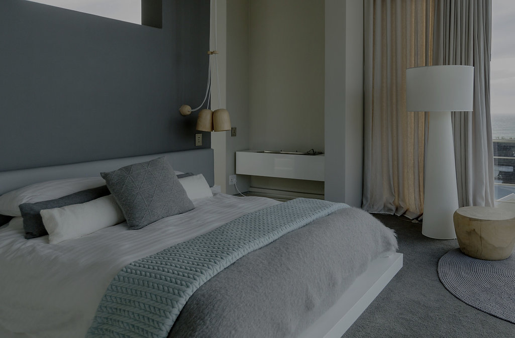 modern decorated bedroom in grey by Phoenix Decorators 2021