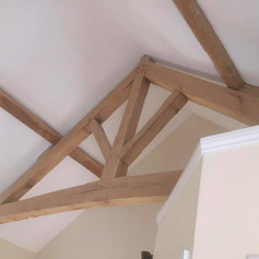 Attic room painted and decorated exposed beams by Phoenix Decorators Worcester 2021