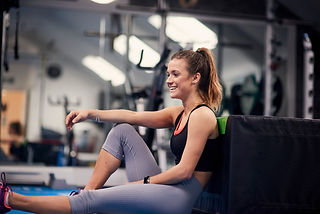 smiling girl taking a break at the gym