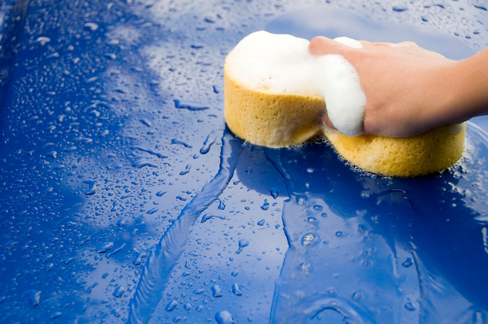 Close up of soap sponge cleaning a blue car Orchard Auto Mobile Car Valeting 2021 Edinburgh