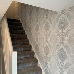 Decorated hall, stairs, and landing area by Phoenix Decorators Worcester 2021
