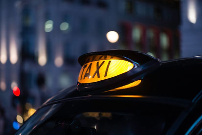 Close up of taxi sign Orchard Auto Mobile Car Valeting 2021 Edinburgh