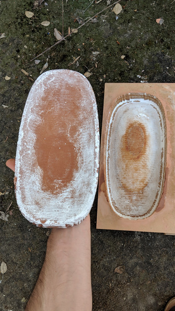 The first press mold exploded in the kiln from air pockets, then they got better from there.