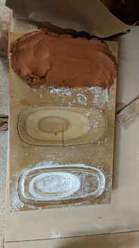 CNC'd press mold with clay in one mold.