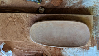 Sanding the base of an almost bone dry body.