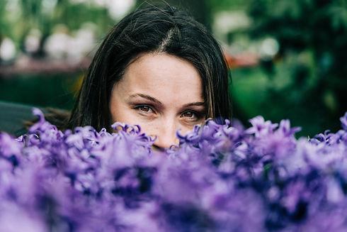 woman-behind-purple-flowers-2480077.jpg