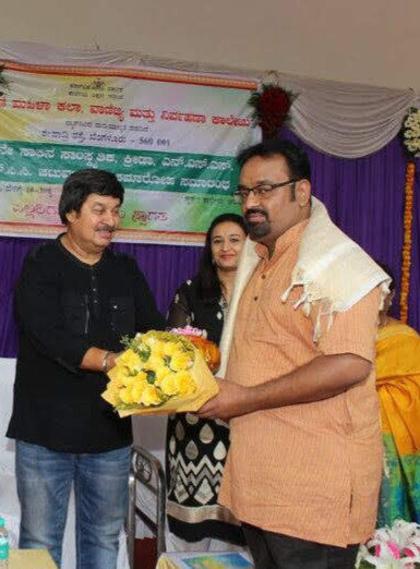 Dr. Nagendra Shastry receiving award Reknowned film actor Srinath