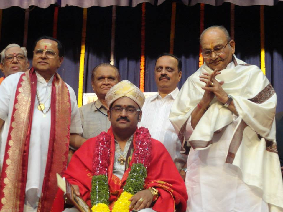 Dr. Srikantham Nagendra Shastry receiving Adibhatla Narayana Dasu National Award from reknowned film director Padmashri K Vishwanath and Vid. RK Padmanabha