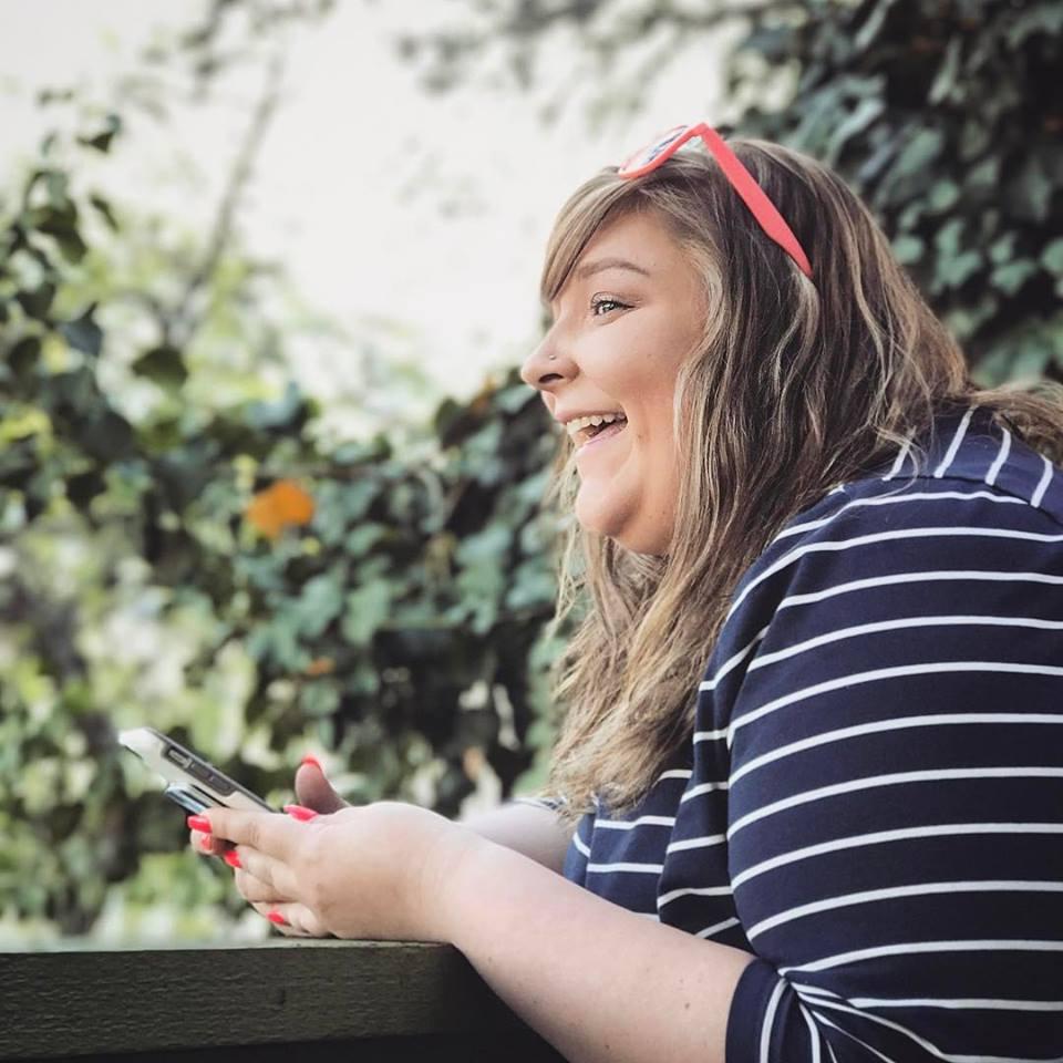 Felisha A. Bull, laughing, stripes