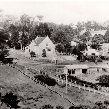 View of Anglican Church in background with Moriarty's Blacksmith shop in foreground