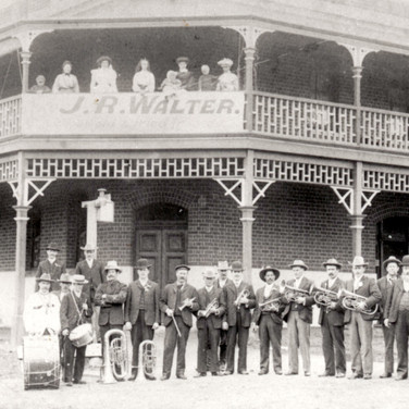 Farmers Home with J. R. Walter band in the front c1900 (later to become Scott's Hotel)