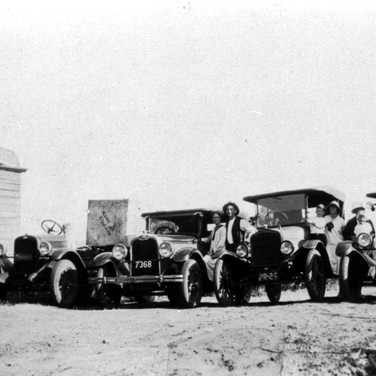 Mr Henry & friends showing off their T. Model Fords, Chevrolet & an unknown model c1930