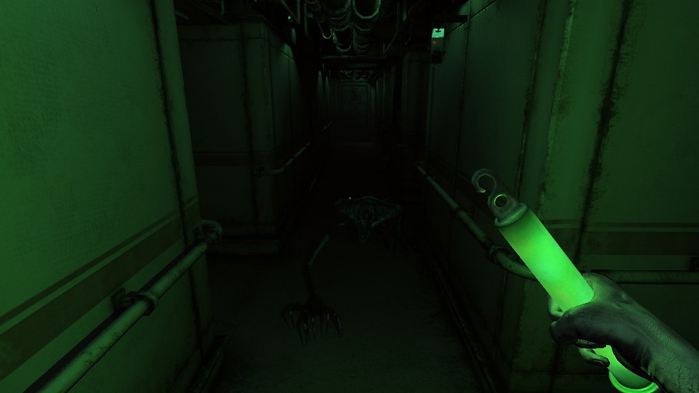 A screenshot of Monstrum 1, showing a first-person perspective of the player inside the abandoned ship. The player is wielding a glow-stick, and so everything is cast in a dim green light.