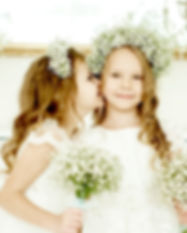 two little girls in wedding dresses stan