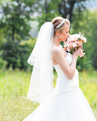Beautiful bride with wedding bouquet of