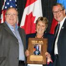 Peggy Spieger receiving IASA Distinguish