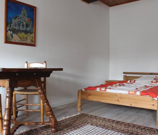 Sitzbereich und Schlafbereich in Zimmer 2