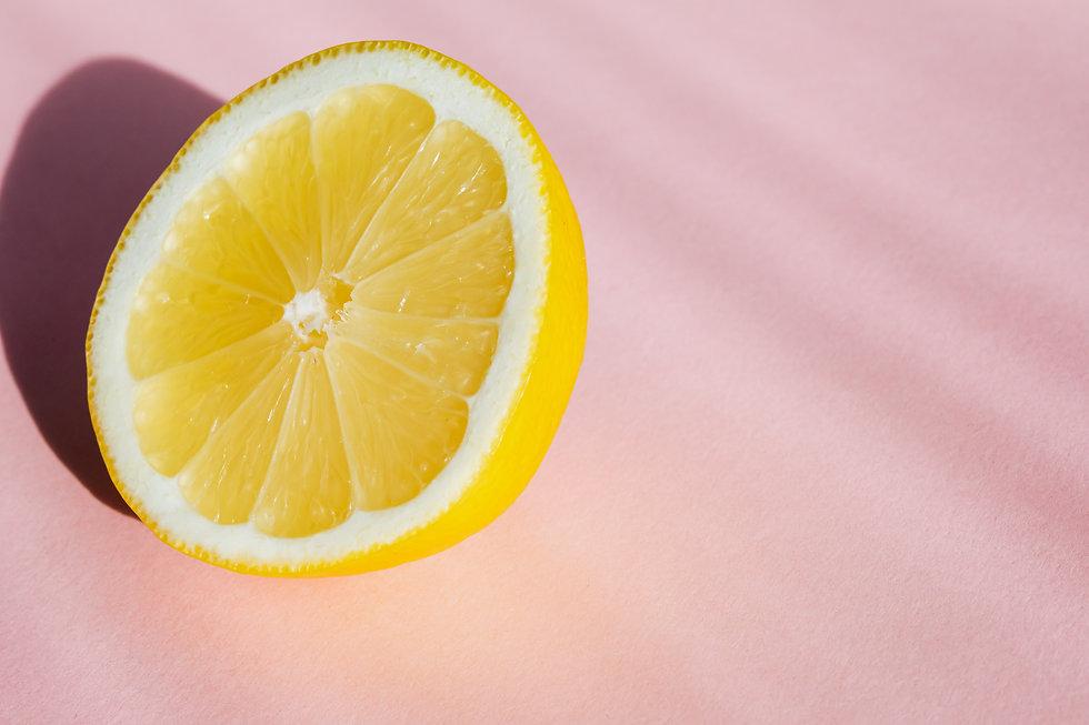half-of-ripe-juicy-lemon-on-table-402187