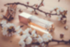 Bottle of perfume with apricot blossom,