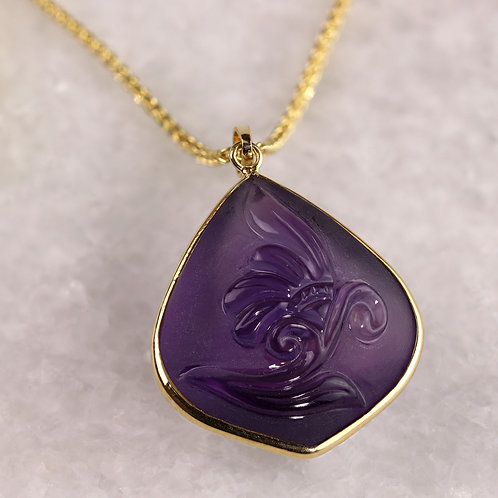 Carved Amethyst Pendant
