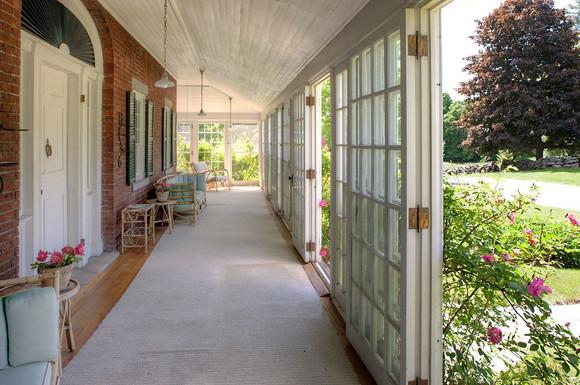 Enclosed porch encompasses 3 sides of ma