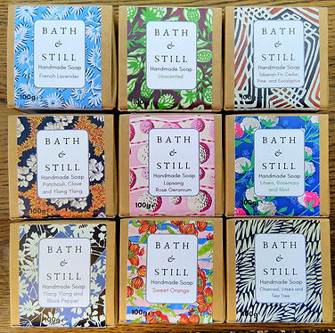 A selection of pure luxury vegan soaps in vibrant box packaging