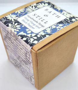 A cube of luxury vegan soap scented with ylang ylang and black pepper