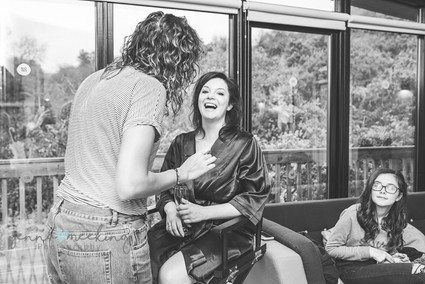 maid of honour laughing whilst getting her makeup done Yorkshire wedding photography