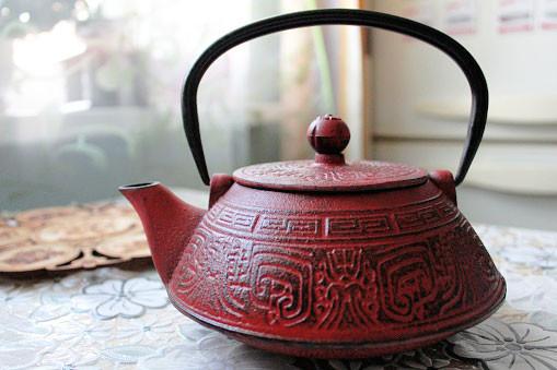 cast iron red teapot