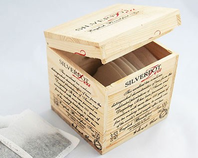 wooden tea box filled in with tea bags